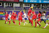 ORLANDO CITY, FL - FEBRUARY 18: Vanessa Gilles #23 of Canada heads a ball during a game between Canada and USWNT at Exploria Stadium on February 18, 2021 in Orlando City, Florida.
