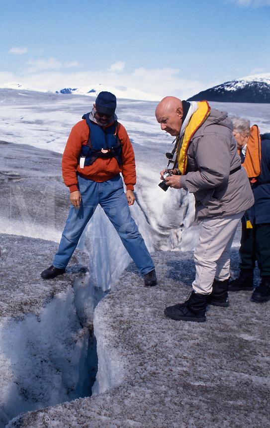 Exploring glacial crevice, Alaska