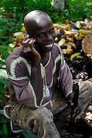 Kuapa Kokoo worker talks on a mobile phone. Kuapa Kokoo is a cocoa farmers' co-operative with 45,000 members spread across the forests of Kumasi. The farmers jointly own a 45 percent stake in the company, which is also a major stakeholder in the London-based fair trade company Divine Chocolate Ltd..