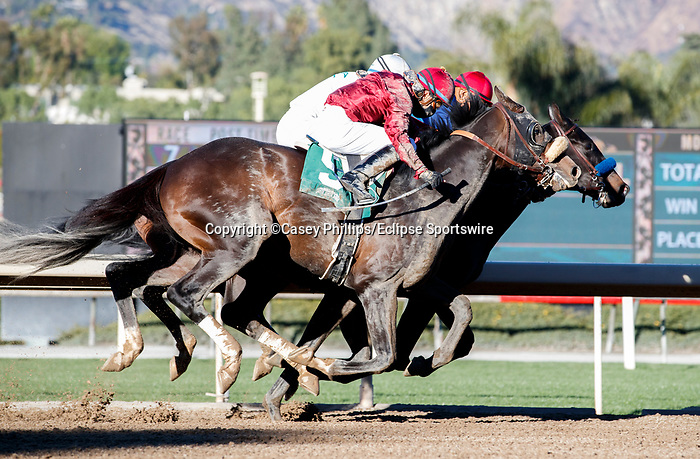 ARCADIA, CA JANUARY 30: #5 Roman Centurian, ridden Juan Hernandez, #4 Hot Rod Charlie, ridden by Joel Rosario, and #1 Medina Spirit, ridden by Abel Cedillo, battle in the stretch of the Robert B. Lewis Stakes (Grade lll) on January 30, 2021 at Santa Anita Park in Arcadia, CA  (Photo by Casey Phillips/EclipseSportswire/CSM)