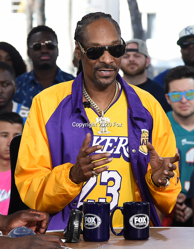 """MIAMI BEACH, FL - JANUARY 29: Snoop Dogg on the set of """"Skip & Shannon: Undisputed"""" on the Fox Sports South Beach studio during Super Bowl LIV week on January 29, 2020 in Miami Beach, Florida. (Photo by Frank Micelotta/Fox Sports/PictureGroup)"""