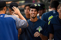Center fielder Jacob Zanon (21) of the Columbia Fireflies is greeted after scoring a run in a game against the Charleston RiverDogs on Monday, August 7, 2017, at Spirit Communications Park in Columbia, South Carolina. Columbia won, 6-4. (Tom Priddy/Four Seam Images)