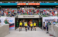 AUSTIN, TX - JUNE 16: Katja Koroleva and the other referees enter the field before a game between Nigeria and USWNT at Q2 Stadium on June 16, 2021 in Austin, Texas.