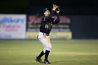 Kannapolis Intimidators shortstop Mitch Roman (10) catches a pop fly in shallow left field during the game against the Hickory Crawdads at Kannapolis Intimidators Stadium on April 22, 2017 in Kannapolis, North Carolina.  The Intimidators defeated the Crawdads 10-9 in 12 innings.  (Brian Westerholt/Four Seam Images)