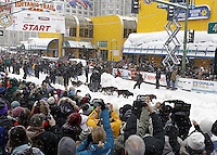 Saturday, March 3, 2012  The crowd is massive as they line 4th avenue to watch 2011 Iditarod champion John Baker leave the Ceremonial Start of Iditarod 2012 in Anchorage, Alaska.