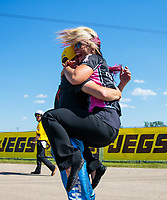 Jun 3, 2018; Joliet, IL, USA; Angie Smith leaps into the arms of her husband, NHRA pro stock motorcycle rider Matt Smith as he celebrates after winning the Route 66 Nationals at Route 66 Raceway. Mandatory Credit: Mark J. Rebilas-USA TODAY Sports