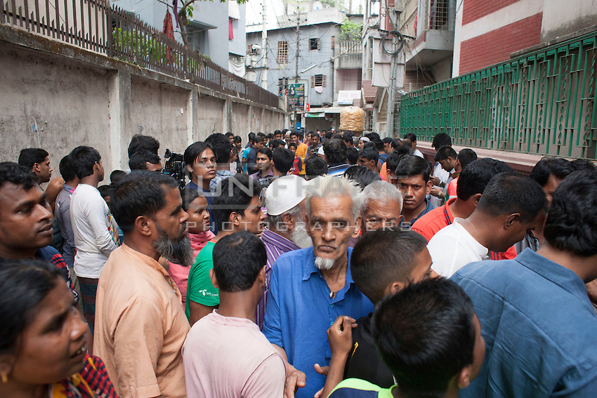Bangladeshi people crowded on the crime scene where Oyasiqur Rahman Babu hacked to death. Bangladeshi blogger Oyasiqur Rahman Babu hacked to death today around 9:45am at the Tejgaon Indsutrial area in Dhaka, Bangladesh, March 30, 2015. Two madrasa students have been detained with sharp weapons for suspected involvement with the murder. Three meat cleavers have been recovered from the spot. This assassination follows a similar murder of blogger-writer Avijit Roy on Feb 25 at the Dhaka University campus. The two arrested for suspected involvement are  'Zikrullah', a Chittagong madrassa student ,  and Arif', a student of  a madrasa in Dhaka's Mirpur area, according to police.