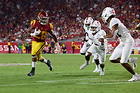 LOS ANGELES, CA - SEPTEMBER 11: Keaontay Ingram #28 of the USC Trojans is pursued by Zahran Manley #31, Noah Williams #9, and Levani Damuni #3 of the Stanford Cardinal during a game between University of Southern California and Stanford Football at Los Angeles Memorial Coliseum on September 11, 2021 in Los Angeles, California.