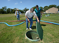 Al Drinkwater (center), a volunteer environmental quality consultant, and Kim Patulak, human resources director for the city of Springdale, look at equipment Friday, Aug. 21, 2020, as Heath Ward, executive director of Springdale Water Utilities, and Chris Clark, financial analyst for Springdale Water Utilities, speak while the four inspect the former Bethel Heights wastewater treatment facility. The Benton County Election Commission certified that the results of an Aug. 11 election to annex Bethel Heights into Springdale. Visit nwaonline.com/200823Daily/ for today's photo gallery.<br /> (NWA Democrat-Gazette/Andy Shupe)
