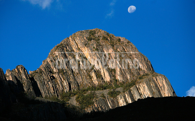 The moon rises over a mountain near Cancha Cancha, Peru, in the Lares Valley, on May 15, 2008. The Lares Valley contains crystal-clear lakes and unspoiled mountain vistas. The Quechua, indigenous Inca people of Southern Peru with their small villages dotting the region, also populates the network of valleys.