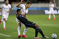 SAN JOSE, CA - OCTOBER 28: Aaron Herrera #22 of Real Salt Lake battles for the ball with Marcos Lopez #27 of the San Jose Earthquakes during a game between Real Salt Lake and San Jose Earthquakes at Earthquakes Stadium on October 28, 2020 in San Jose, California.