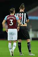 Aaron Cresswell and Andy Carroll of Newcastle United during West Ham United vs Newcastle United, Premier League Football at The London Stadium on 12th September 2020