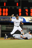 Lakeland Flying Tigers shortstop Dixon Machado (1) attempts to turn a double play as third baseman Dante Bichette Jr. (25) slides in during a game against the Tampa Yankees on April 5, 2014 at Joker Marchant Stadium in Lakeland, Florida.  Lakeland defeated Tampa 3-0.  (Mike Janes/Four Seam Images)