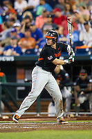 Miami Hurricanes catcher Zack Collins (0) at bat against the Florida Gators in the NCAA College World Series on June 13, 2015 at TD Ameritrade Park in Omaha, Nebraska. Florida defeated Miami 15-3. (Andrew Woolley/Four Seam Images)