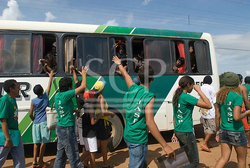 "Altamira, Brazil. ""Xingu Vivo Para Sempre"" protest meeting about the proposed Belo Monte hydroeletric dam and other dams on the Xingu river and its tributaries. Kayapo Indian warrior say goodbye to young peoples movement from a bus."