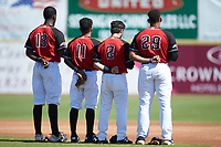(L-R) Hickory Crawdads infielders Sherten Apostel (13), Frainyer Chavez, Tyler Depreta-Johnson (2), and Curtis Terry (29) stand for the National Anthem prior to the game against the Charleston RiverDogs at L.P. Frans Stadium on May 13, 2019 in Hickory, North Carolina. The Crawdads defeated the RiverDogs 7-5. (Brian Westerholt/Four Seam Images)