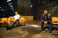 "Pictured: Actors Ioan Hefin and Simon Nehan <br /> Re: Press rehearsal of ""We'Re Still Here"", a play created by Rachel Trezise, Common Wealth and the National Theatre Wales about steelworkers, which will be performed in Byass Works, a disused industrial unit, in Port Talbot, south Wales, UK."