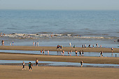 Holiday-makers on the beach at Camber Sands, Kent.