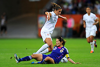 Carli Lloyd (l) of team USA and Homare Sawa of team Japan during the FIFA Women's World Cup Final USA against Japan at the FIFA Stadium in Frankfurt, Germany on July 17th, 2011.