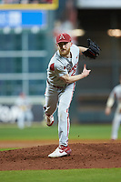 Arkansas Razorbacks relief pitcher Marshall Denton (29) follows through on his delivery against the Texas Longhorns in game six of the 2020 Shriners Hospitals for Children College Classic at Minute Maid Park on February 28, 2020 in Houston, Texas. The Longhorns defeated the Razorbacks 8-7. (Brian Westerholt/Four Seam Images)