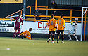 Arbroath's Derek Holmes (10) scores their first goal .