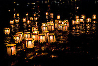 Inscribed with the names of the departed, paper lanterns ride the outgoing tide to greet visiting spirits at Ali'i Beach Park as part of the annual bon dance and Toro Nagashi (ìfloating lanterns set out to seaî) ceremony in Haleiwa.