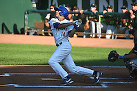 Michael Ahmed (14) of the Ogden Raptors at bat against the Great Falls Voyagers in Pioneer League action at Lindquist Field on July 16, 2014 in Ogden, Utah.  (Stephen Smith/Four Seam Images)