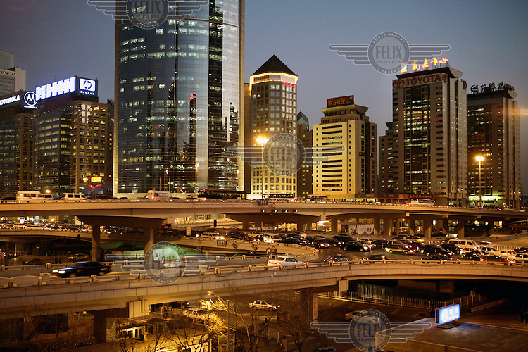 Elevated highways criss-cross in front of the Central Business District (CBD) skyline.