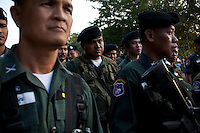 Thai border police look on as Burmese refugees begin to return home after less than three days in Thailand. An estimated 20,000 had fled into Thailand to escape clashes in the border towns of Myawaddy and Pyaduangsu, only a day after a Burmese election which critics described as a sham..Ethnic minorities along the Thai-Burma border had warned earlier that the junta would launch a major offensive after the election, as many armed rebel groups had refused to become part of the government-controlled Border Guard Forces.