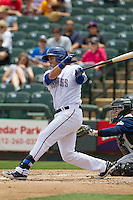 Round Rock Express third baseman Mike Olt #20 follows through on his swing against the New Orleans Zephyrs in the Pacific Coast League baseball game on April 21, 2013 at the Dell Diamond in Round Rock, Texas. Round Rock defeated New Orleans 7-1. (Andrew Woolley/Four Seam Images).