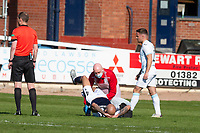 24th April 2021; Dens Park, Dundee, Scotland; Scottish Championship Football, Dundee FC versus Raith Rovers; Liam Fontaine of Dundee gets treatment from physio Gerry Docherty