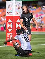 Ruby Tui (NZ) helps up tryscorer Luisa Tisolo during the women's pool match between New Zealand and Fiji on day two of the 2020 HSBC World Sevens Series Hamilton at FMG Stadium in Hamilton, New Zealand on Sunday, 26 January 2020. Photo: Dave Lintott / lintottphoto.co.nz