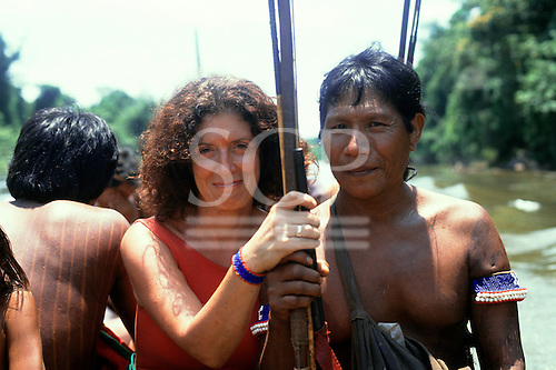 A-Ukre Village, Brazil. Anita Roddick of the Body Shop on a fishing trip with Kayapo Indians. Para State, 1990.