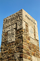 Lifestyle photography of Berewick, a 1,000-acre neighborhood development in Charlotte, NC (Steel Creek Area). Berewick was developed by Pappas Properties. Photo shows the community's iconic stone pillar marking the entrance to Berewick.