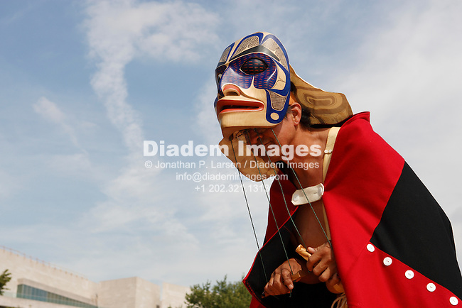 WASHINGTON - SEPTEMBER 25: A; Git-Hoan dancer performs at the First Americans Festival on the National Mall to celebrate the opening of the National Museum of the American Indian September 25, 2004 in Washington, DC.  (Photograph by Jonathan Paul Larsen)