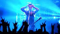 """VOLBEAT im Haus Auensee - die dänischen Elvis Metaller rocken vor rappelvollem Haus und geben den Fans einen Satz heiße Ohren - Tour zum dritten Album """"Guitar Gangsters & Cadillac Blood"""" - die Band um Frontman Michael Poulsen (im Bild rechts oder allein) legte in den letzten zwei Jahren einen Senkrechtstart hin, den so wohl kaum eine andere Band der heutigen Zeit geschafft hat. Jedes Konzert ihrer Tour war restlos ausverkauft. Newcomer Bands reißen sich darum als Support für VOLBEAT spielen zu dürfen - im Bild: """"Rock the rebel / Metal the devil"""" hieß ein früheres Album der Band - Frontman Michael Poulsen macht die Teufelshörnchen... doch in Wahrheit ist er ein ganz Lieber - Mr. """"nice guy"""" bedankte sich mehrfach bei den Fans für die Unterstützung...Foto: Norman Rembarz"""