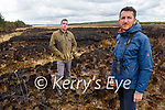 Hubert Servingat (front right) with Shane McAulliffe standing at the Black Banks in Toureenablaha Loughfouder at site of a devastating gorse fire