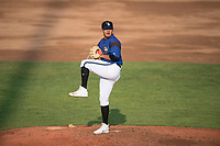 Missoula Osprey starting pitcher Edgar Martinez (15) delivers a pitch during a Pioneer League game against the Grand Junction Rockies at Ogren Park Allegiance Field on August 21, 2018 in Missoula, Montana. The Missoula Osprey defeated the Grand Junction Rockies by a score of 2-1. (Zachary Lucy/Four Seam Images)