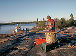 Cleaning fish at Wool Bay on Great Slave lake