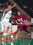 Troy Trojans guard Will Weathers (1) and North Texas Mean Green guard Alzee Williams (3) in action during the game between the Troy Trojans and the University of North Texas Mean Green at the North Texas Coliseum,the Super Pit, in Denton, Texas. UNT defeats Troy 87 to 65.....