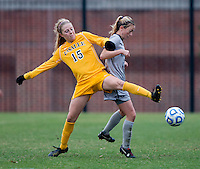 Colleen Dinn (24) of Georgetown fights for the ball with Kelsey Haycook (15) of La Salle during the first round of the NCAA tournament at Shaw Field in Washington, DC.  Georgetown defeated La Salle, 2-0.