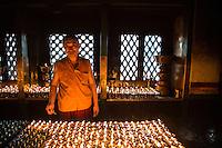 Monk Lighting Candles at Swayambhunath, Nepal