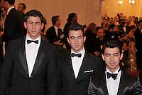 Nick Jonas, Kevin Jonas and Joe Jonas at the 'Schiaparelli And Prada: Impossible Conversations' Costume Institute Gala at the Metropolitan Museum of Art on May 7, 2012 in New York City. ©mpi03/MediaPunch Inc.