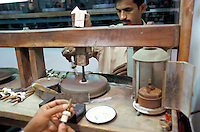 In Jaipur India, the world capital leader of Emerald cutter, those mens are giving the second polishing cut on the stone