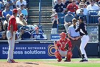 Shortstop Derek Jeter (2) of the New York Yankees at bat facing pitcher Miguel Alfredo Gonzalez in front of catcher Cameron Rupp and umpire Dan Iassogna during a spring training game against the Philadelphia Phillies on March 1, 2014 at Steinbrenner Field in Tampa, Florida.  New York defeated Philadelphia 4-0.  (Mike Janes/Four Seam Images)
