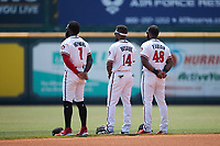 (L-R) Richmond Flying Squirrels outfielders Jacob Heyward (7), Luis Alexander Basabe (14), and Sandro Fabian (48) stand for the National Anthem prior to the game against the Bowie Baysox at The Diamond on July 28, 2021, in Richmond Virginia. (Brian Westerholt/Four Seam Images)