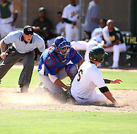 Max Kwan - Chicago Cubs - 2010 Instructional League. Kwan tags out the Athletics runner Wade Kirkland at home plate in a game at Papago Park, Phoenix, AZ - 10/01/2010.Photo by:  Bill Mitchell/Four Seam Images..