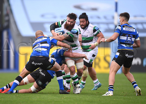 21st November 2020; Recreation Ground, Bath, Somerset, England; English Premiership Rugby, Bath versus Newcastle Falcons; Gary Graham of Newcastle Falcons is held up by Miles Reid and Jack Walker of Bath