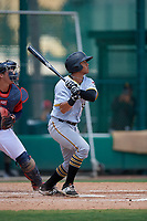 GCL Pirates left fielder Calvin Mitchell (52) hits a double during a game against the GCL Braves on July 27, 2017 at ESPN Wide World of Sports Complex in Kissimmee, Florida.  GCL Braves defeated the GCL Pirates 8-6.  (Mike Janes/Four Seam Images)