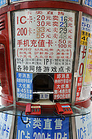 A shop advertises the sale of SIM cards in Guangzhou, China.  ....
